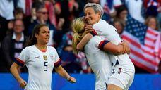 United States' midfielder Lindsey Horan (C) celebrates with