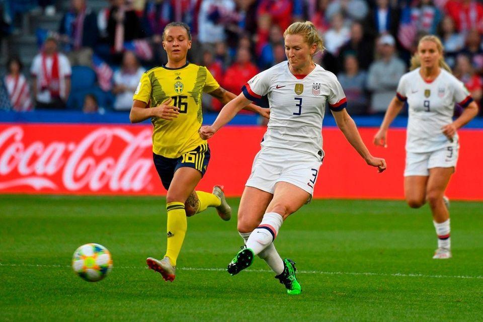 United States' midfielder Sam Mewis (R) vies for