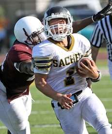 Sachem North's Trent Crossan runs down the sideline.