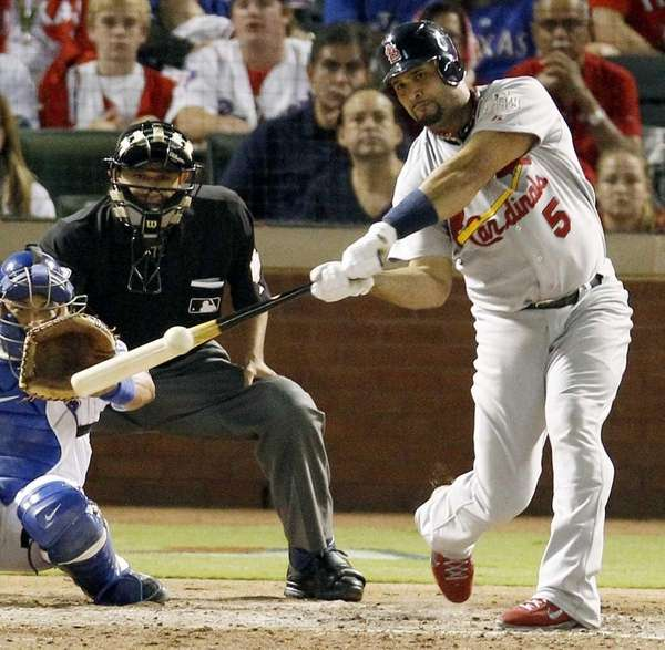 St. Louis Cardinals' Albert Pujols singles against the