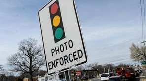 A sign warning of a red-light camera at