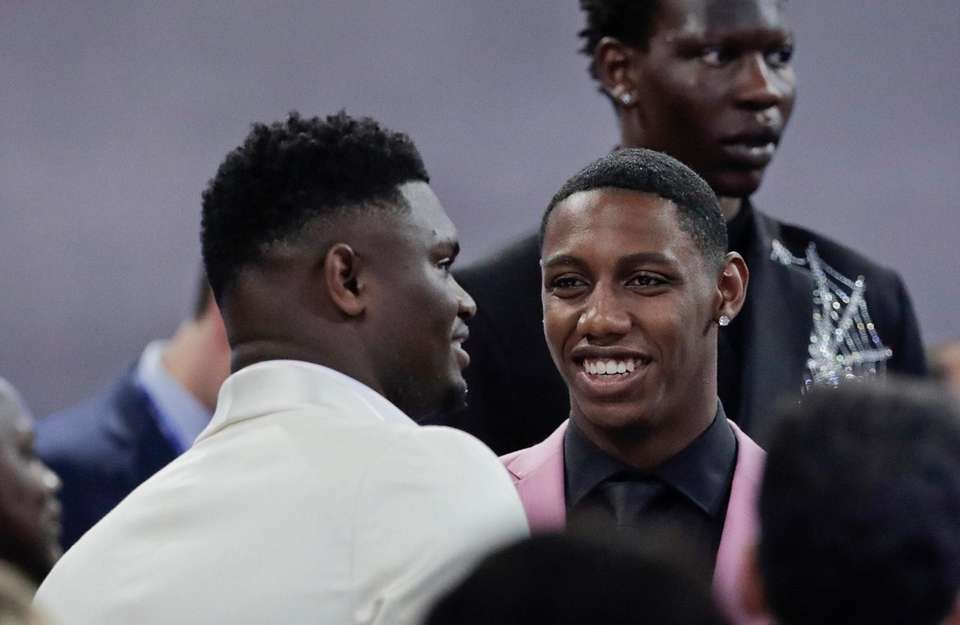 Duke's RJ Barrett, center, talks to Zion Williamson,
