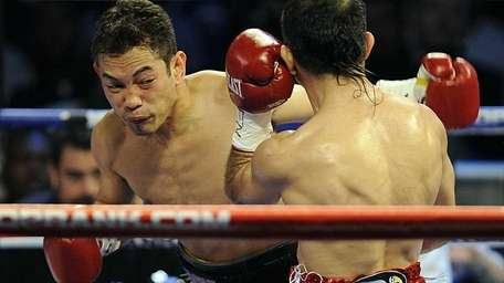 Nonito Donaire throwing a left hook to the