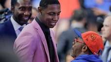 Duke's RJ Barrett talks to Spike Lee, right,