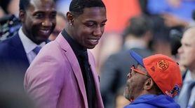 Duke's RJ Barrett talks to Spike Lee, right,