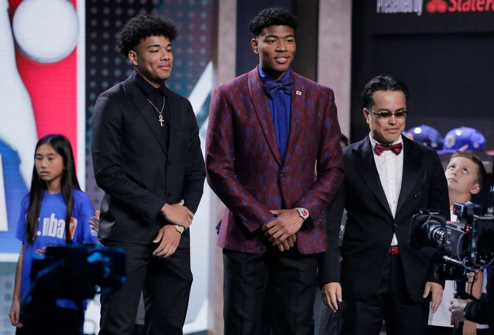 Japan's Rui Hachimura, center, of Gonzaga, poses for