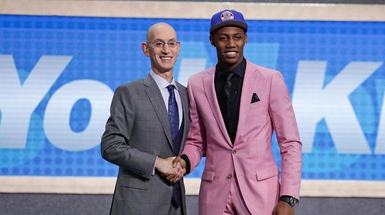RJ Barrett, right, poses with NBA commissioner Adam