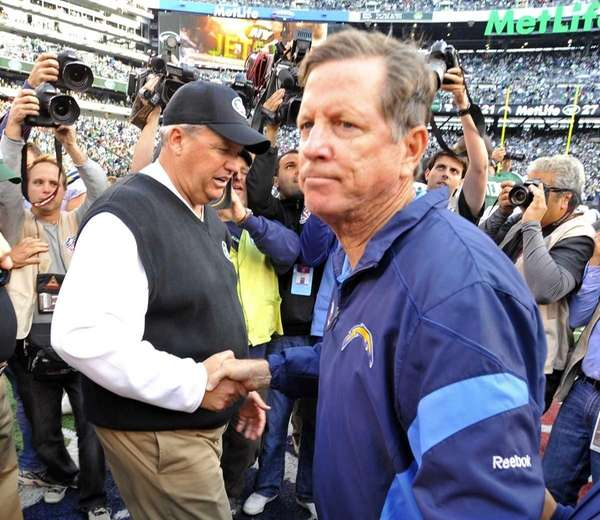 Rex Ryan and Norv Turner shake hands at