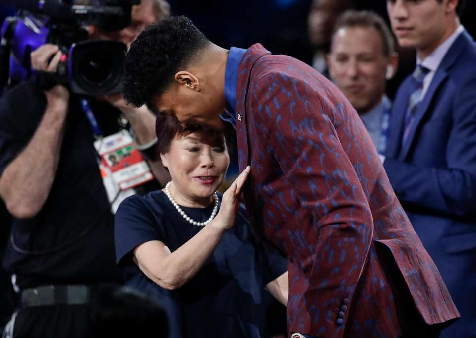 Japan's Rui Hachimura, of Gonzaga, hugs loved ones