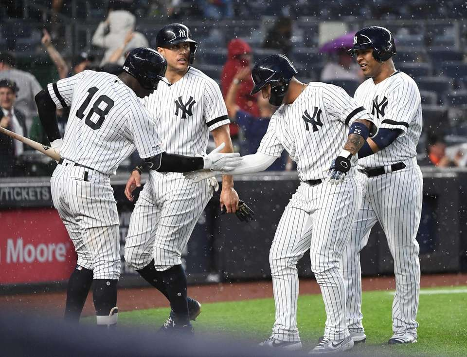 Yankees' Gleyber Torres, second from right, is congratulated