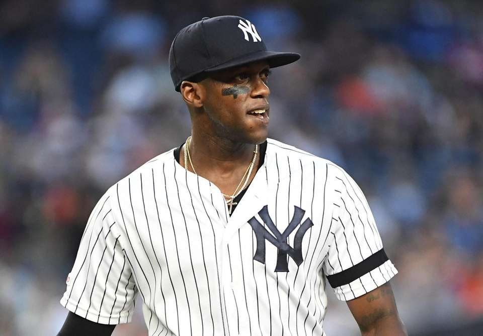 Yankees leftfielder Cameron Maybin looks on against the