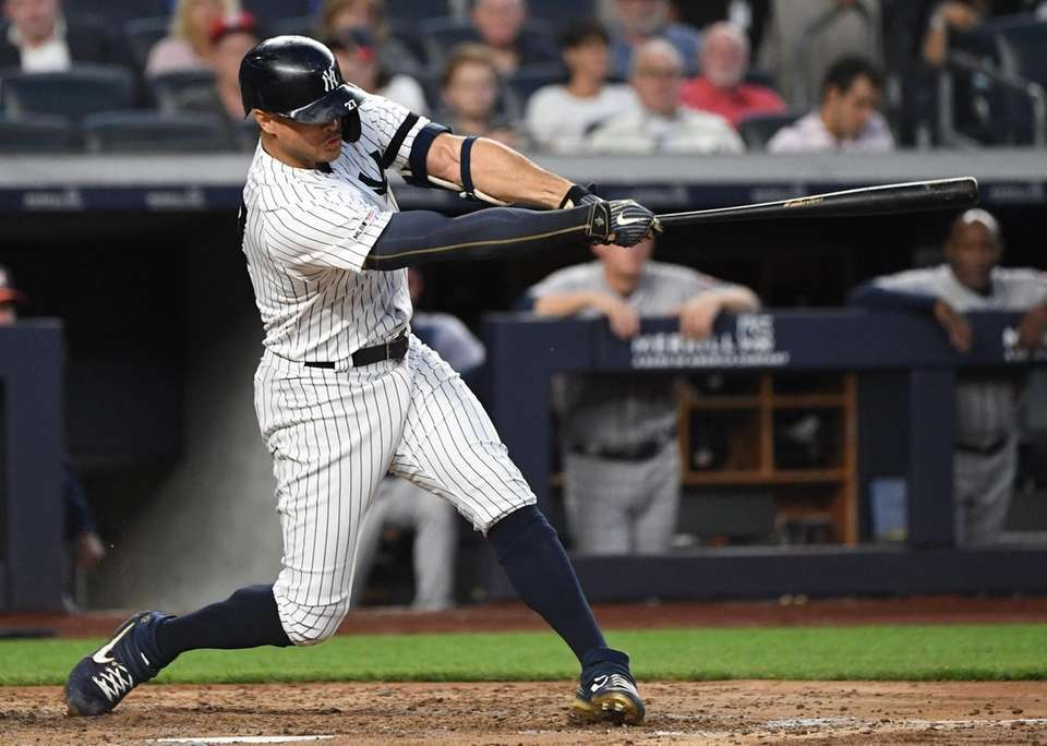 New York Yankees right fielder Giancarlo Stanton doubles