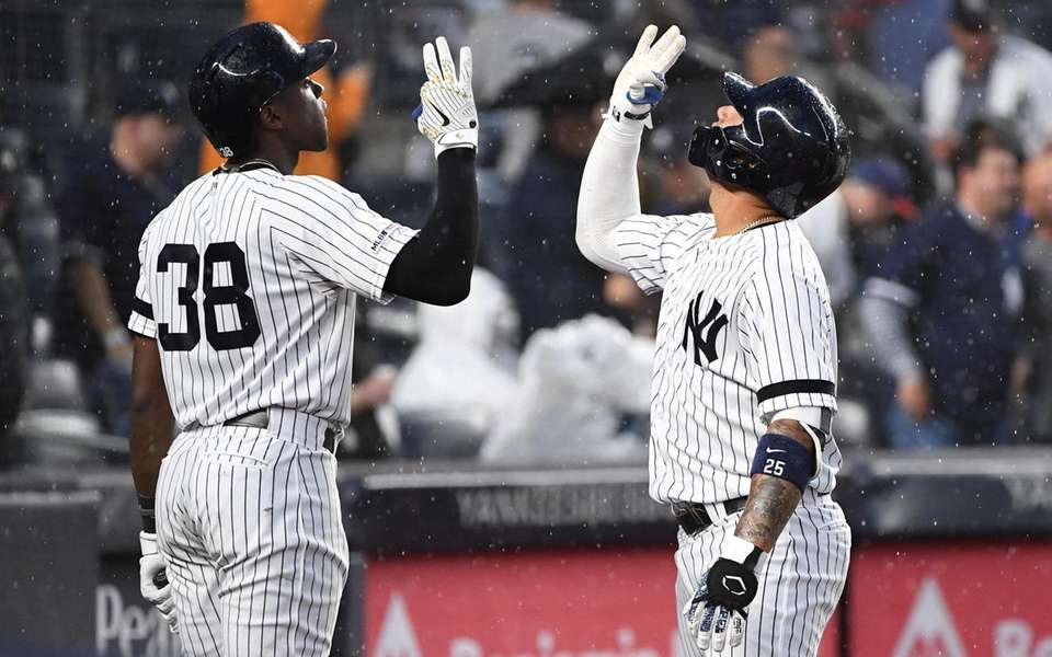 New York Yankees' Gleyber Torres, right, and Cameron