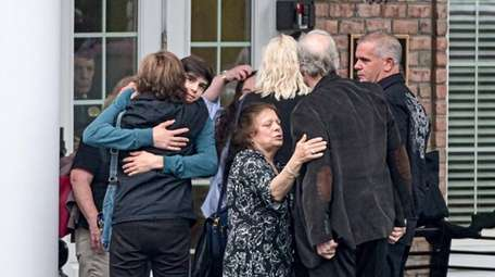 Mourners at a wake for Melissa Marchese console