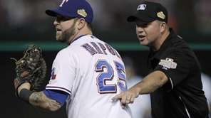 Texas Rangers' Mike Napoli reacts after umpire Ron