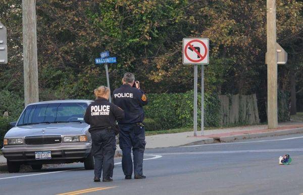 Police investigate a crash near Montauk Highway in