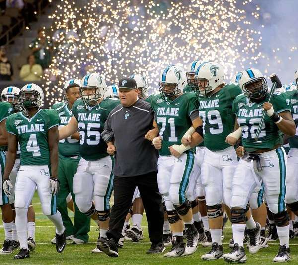Tulane coach Mark Hutson takes the field with