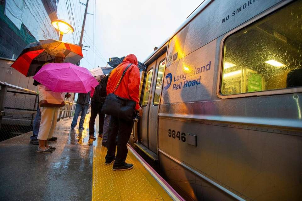 Commuters dodge raindrops as they begin their early