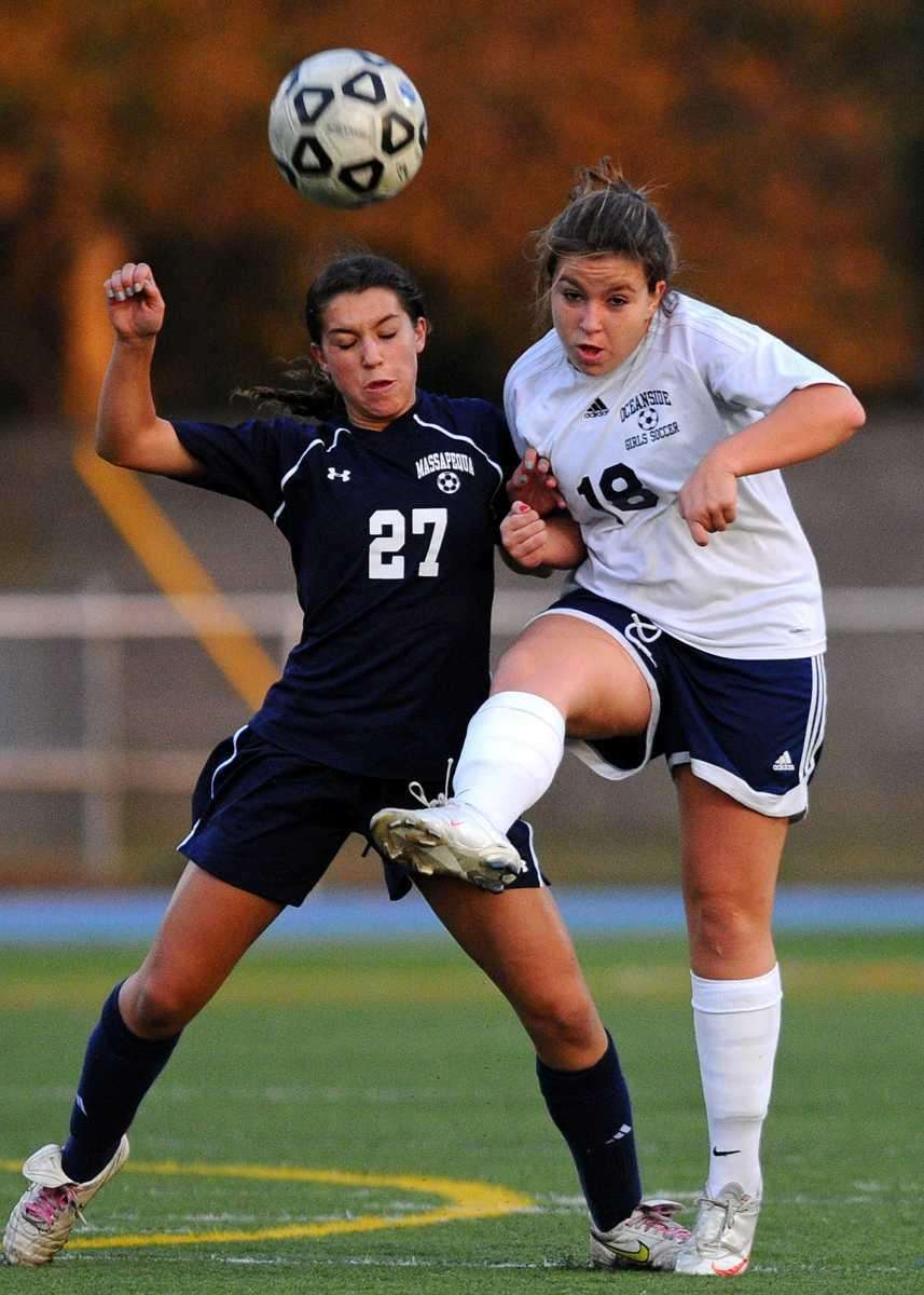 Massapequa High School's Olivia Stegner, left, pressures Oceanside's