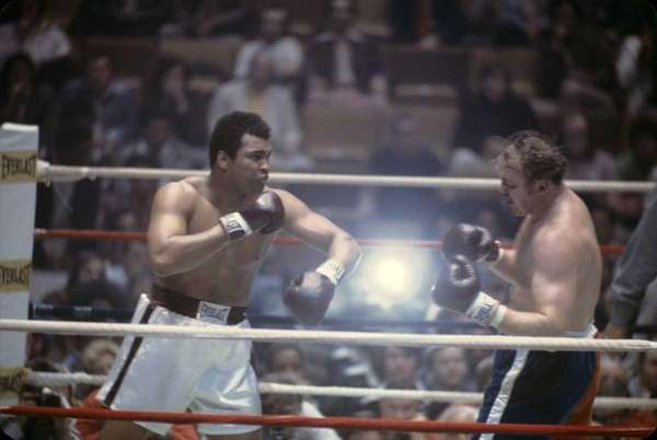 World heavyweight champion boxer Muhammad Ali follows through