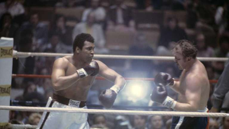 World heavyweight champion boxer Muhammad Ali follows through