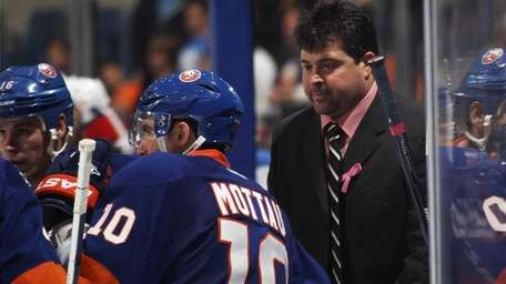 Islanders head coach Jack Capuano gives players instructions