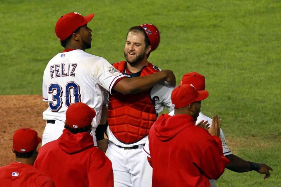Mike Napoli and Neftali Feliz celebrate after defeating