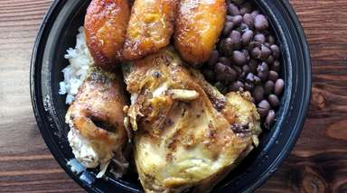"A ""Cana"" bowl of rice, beans, plantains and"