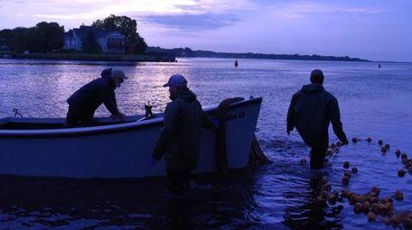 Tom Gariepy, Lenny Nilson and Kenny Anderson fish