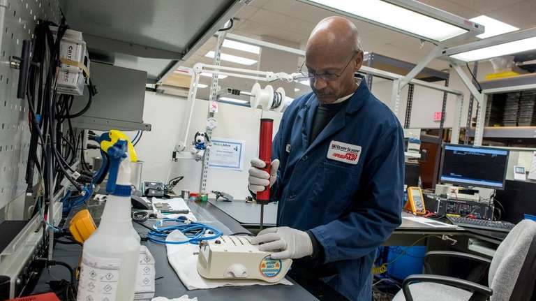 Employees work on dental tool repair at the