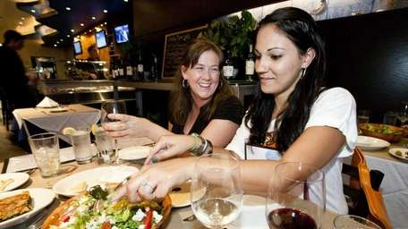 Danielle Cullen, on left, shares a Greek salad