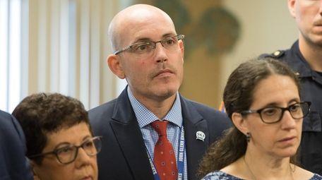 Elwood schools Superintendent Kenneth Bossert looks on during