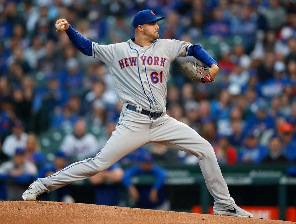 New York Mets' Walker Lockett pitches against the