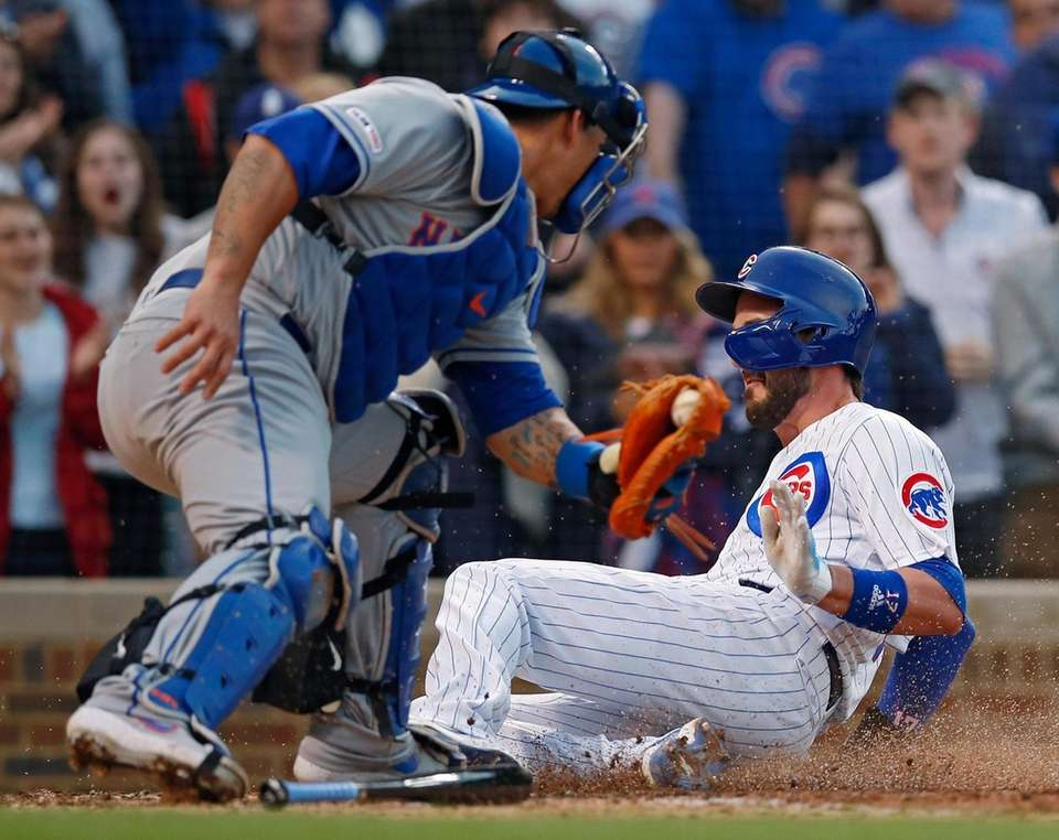 Chicago Cubs' Kris Bryant, right, slides safely into