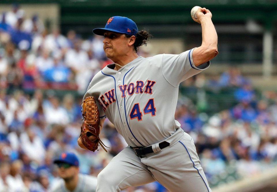 New York Mets starting pitcher Jason Vargas throws
