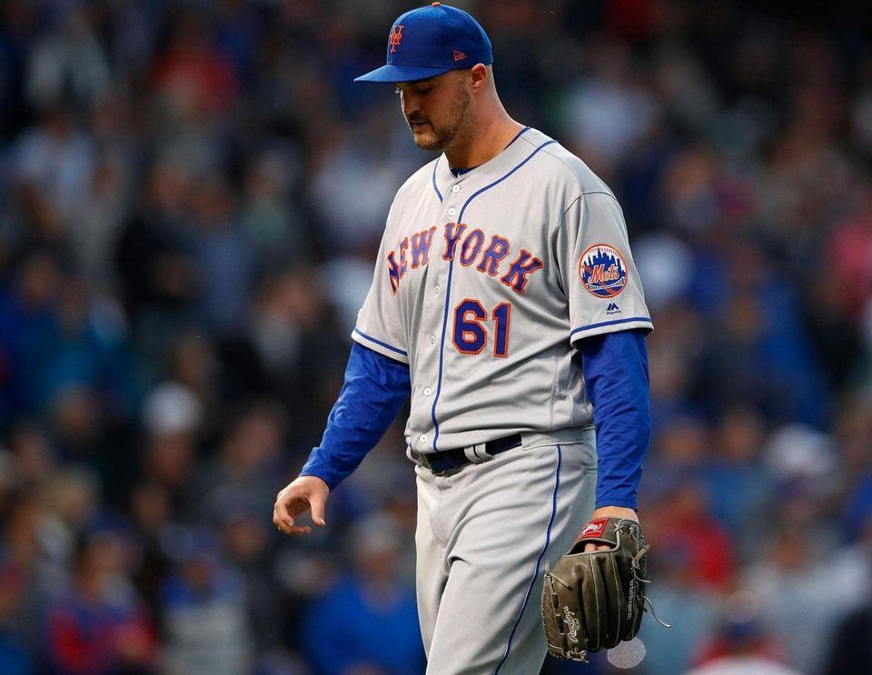 New York Mets' Walker Lockett walks back to
