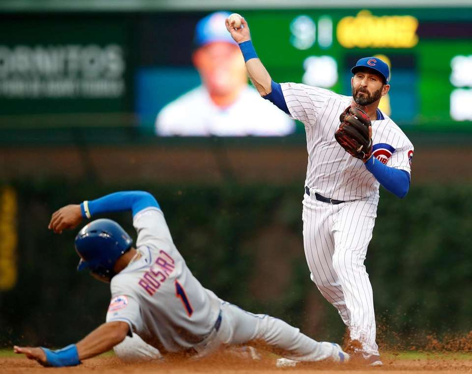 New York Mets' Amed Rosario, left, is out