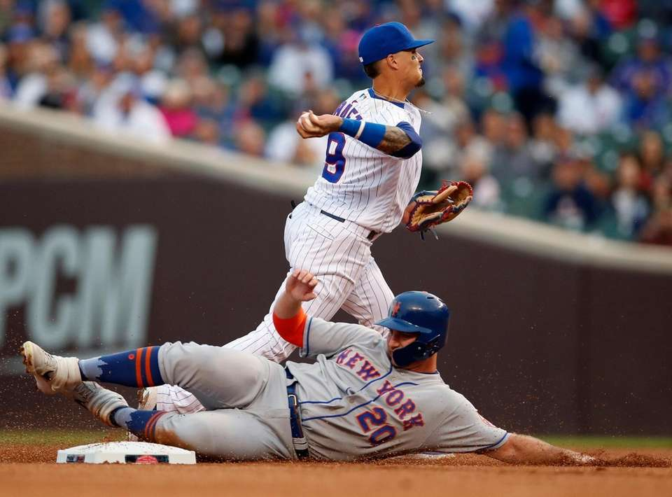 New York Mets' Pete Alonso, bottom, is out