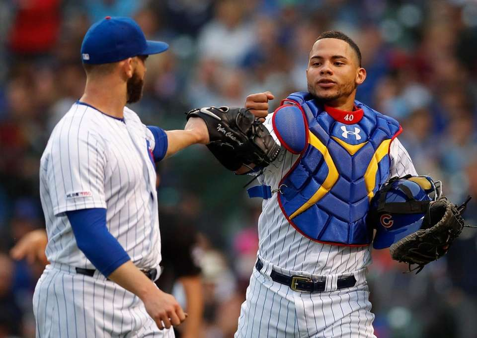 Chicago Cubs pitcher Tyler Chatwood, left, and catcher