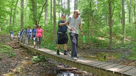 Hikers get some exercise through Blydenburgh Park in