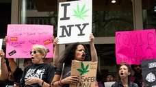Marijuana legalization supporters rally on June 16 outside