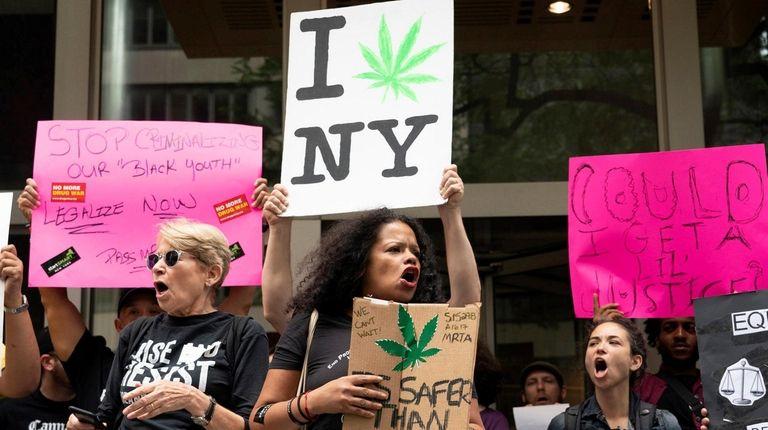 Marijuana legalization supporters rally on June 16 outside