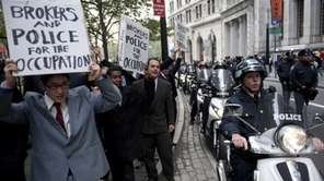 Approximately 10 Occupy Wall Street demonstrators, dressed in