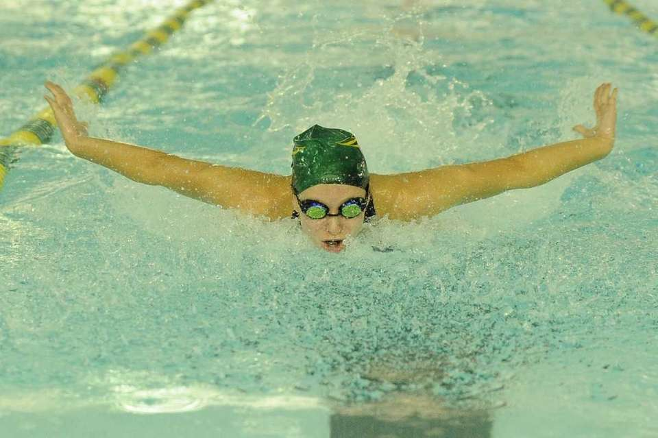 Ward Melville's Rachael Bertini swims the 100 butterfly