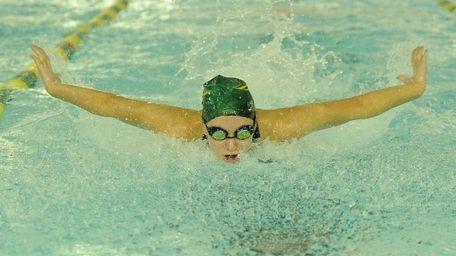 Ward Melville's Rachael Bertini swims the 100 butterfly