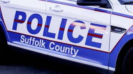 Suffolk County Police Department patrol cars outside the