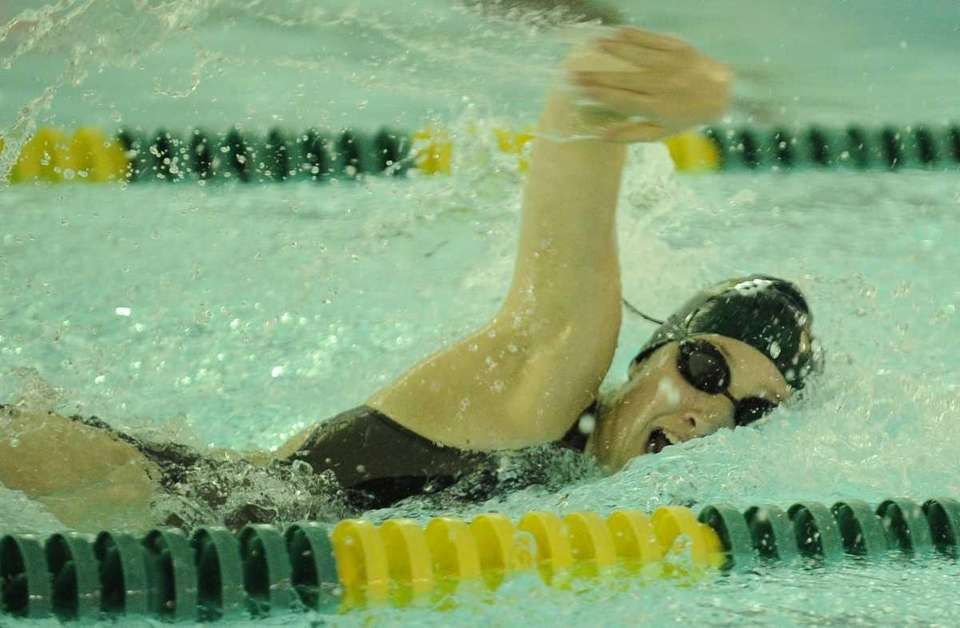 Ward Melville's Phoebe McAuliffe swims the freestyle in