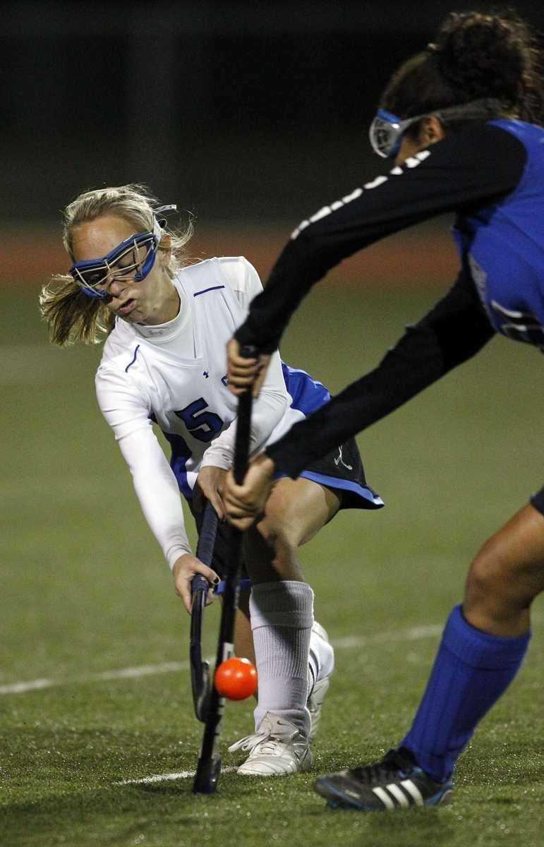 Copiague's Jackie Clemens (5) drives the ball around