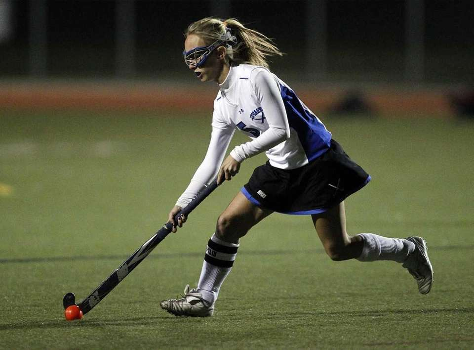 Copiague's Jackie Clemens (5) feeds a passing shot