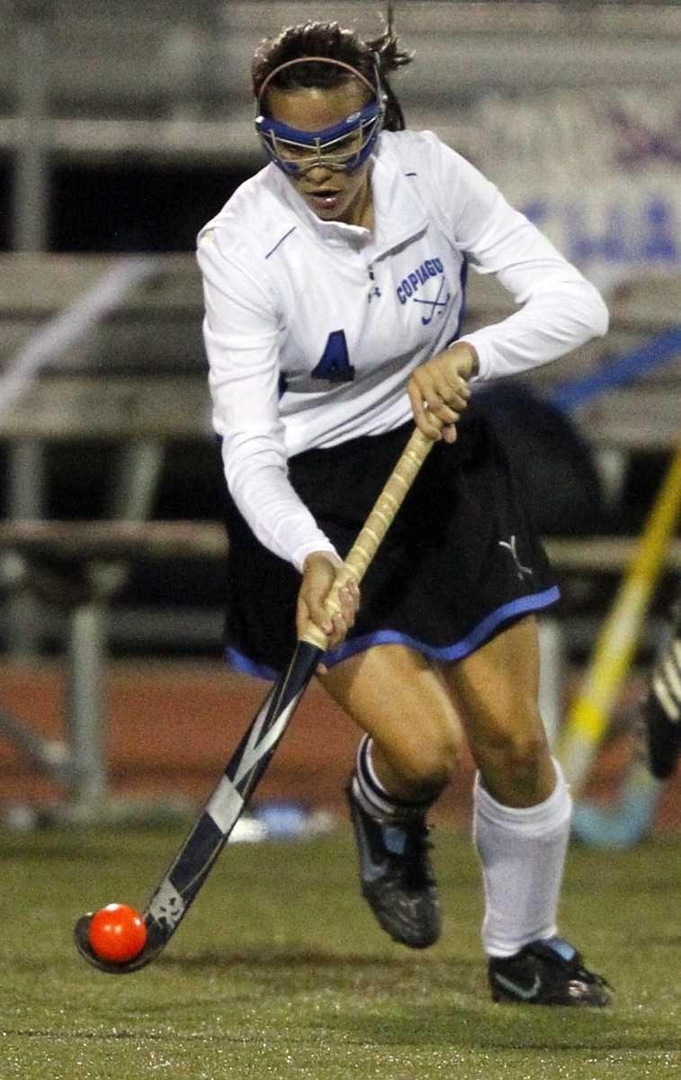 Copiague's Ashley Arquer (4) advances the ball at